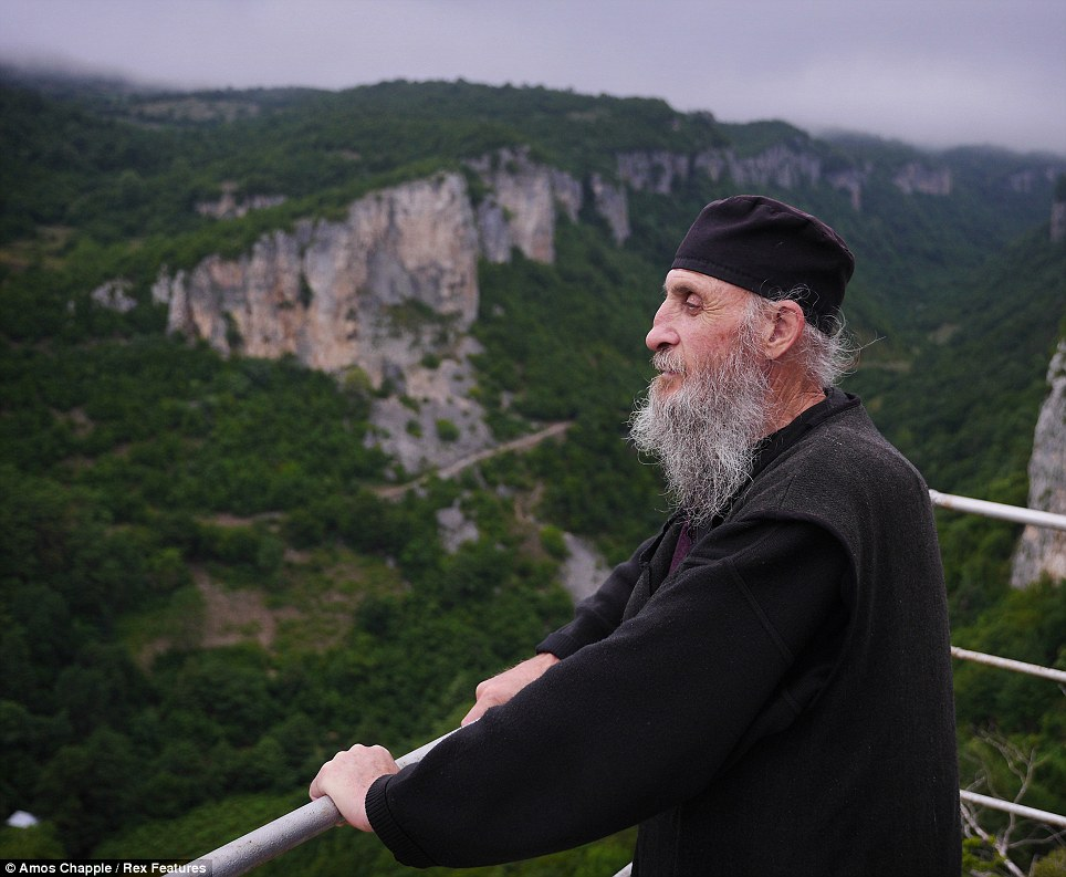 Maxime Qavtaradze has lived atop a rock outcropping in the nation of Georgia for 20 years. (Daily Mail photo)
